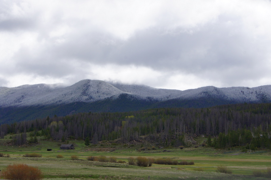 Snow on the mountains between  Butte and Great Falls