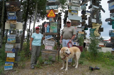 Next to our sign in the signpost forest in Watson Lake, Yukon