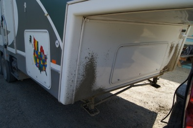 Henry had to scrape mud off the landing gears before we could unhitch the camper