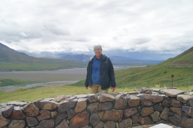At Eielson Visitor's Center with Mt. McKinley hidden in the clouds behind Beth