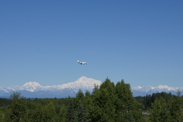 An Airplane flies over Mt. McKinley