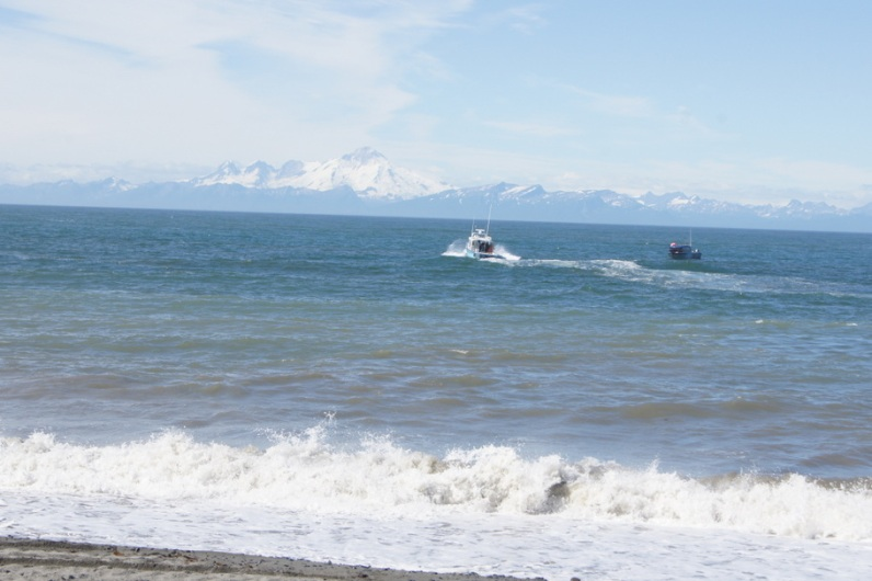 Boats leaving the beach in Ninilchik head into Cook Inlet