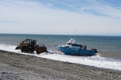 John Deere tractors are used to launch the boats on the beach in Ninilchik