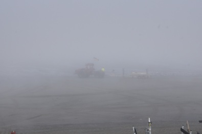 Tractor at Anchor Point bringing in a boat in the fog