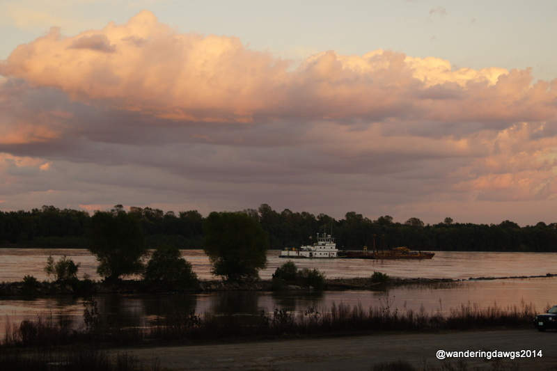 Barge going down the river at sunset