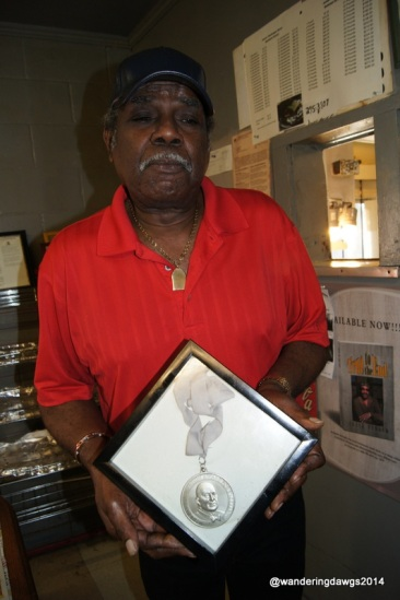 Owner and Pitmaster James Jones holds his James Beard Award