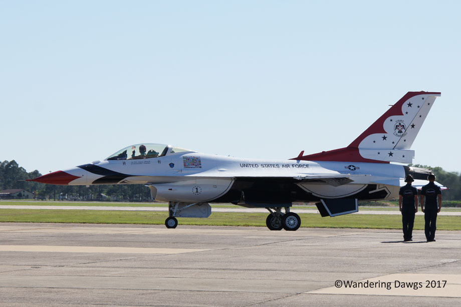 Thunderbird Pilot waves an American Flag as he taxies down the runway